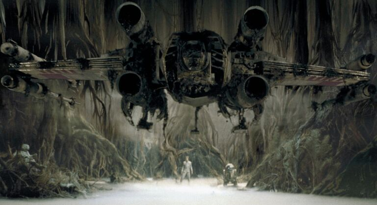 a graphic of Luke Skywalker using the Force to raise an X-Wing on Dagobah